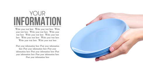 Pastel blue plates in hand on white background isolation, copy space
