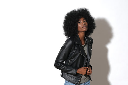High fashion afro-american model in black leather jacket isolated on white background. Studio shoot.