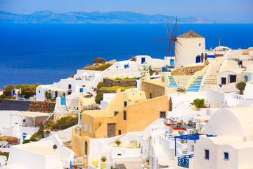 Foto auf Leinwand Santorini Santorini island, Greece, Oia village windmill, white houses and blue sea panorama