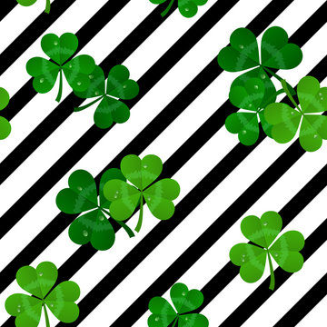 vector stripes seamless black and white pattern with green shamrocks