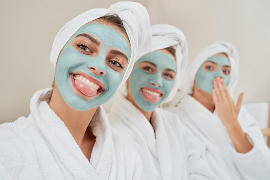 Girls with cosmetic masks taking selfie.
