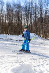 Kid use the button ski lift