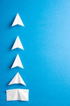 Progress process concept. Agile evelopment attainment, motivation, growth concept. Business concept of goals, success, achievement and challenge. Paper airplanes under construction on blue backgound