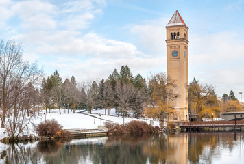 The Great Northern Clocktower along the Spokane River covered in snow at winter in downtown Riverfront Park in Spokane, Washington, USA