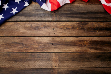 American flag on old brown wooden table
