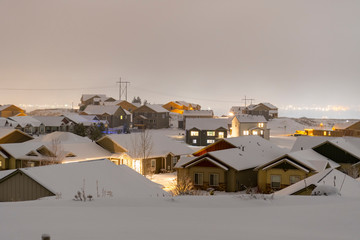 A new construction subdivision in the suburbs of Spokane Washington covered in fog and snow during winter.