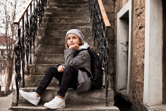 10 years old girl walks on the street dressed in comfortable clothes
