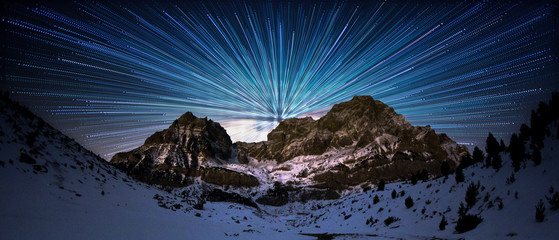 moon over the sea, star trail over the mountain