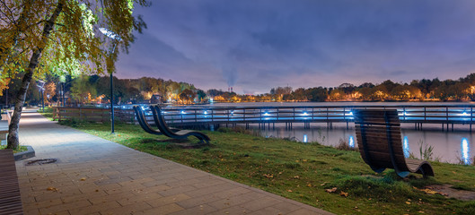 Moscow. October 6, 2019. Meshchersky park in the fall. Beautiful night landscape with a view of the pond and the wooden bridge