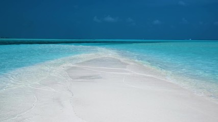 Wall Mural - Waves break on the sandy beach in Maldives