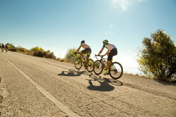 bike race in the morning on  uphill road