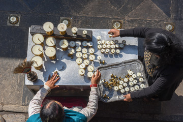People who prepare candles in golden temple at Patan near Kathmandu on Nepal