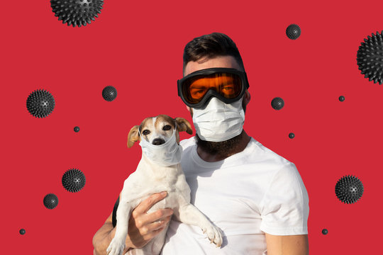 Man in protective mask and glasses holds cute dog in medical mask and abstact virus strain on red