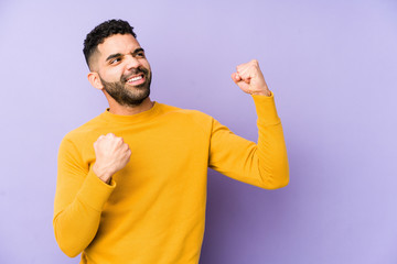 Young mixed race arabic man isolated raising fist after a victory, winner concept.
