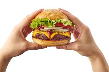 Hands holding hamburger on white
