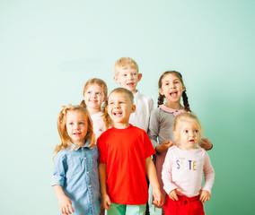 Happy kids singing song together at kindergarden