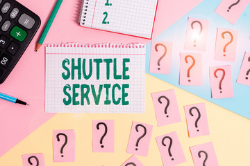 Text sign showing Shuttle Service. Business photo showcasing intended to shuttle passengers between two fixed points Mathematics stuff and writing equipment above pastel colours background