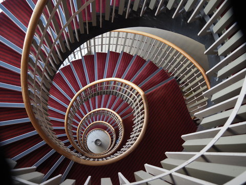 looking down a spiral staircase from above