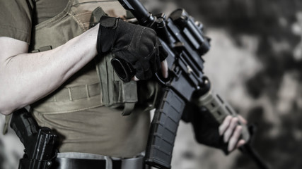 Armed Security contractor holding AR15 Rifle