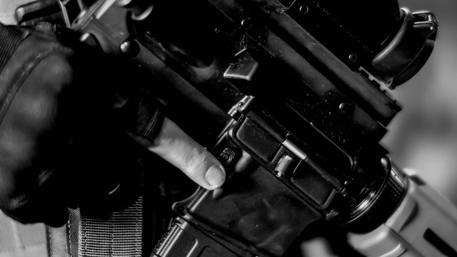Abstract closeup of Security Contractor holding an AR15 rifle