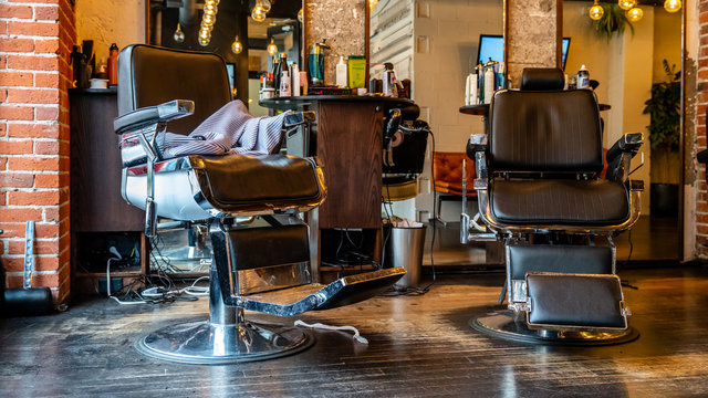 Vancouver, British Columbia / Canada - 12 15 2018: interior of a vintage barber shop. Empty hairdresser chair.