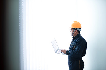 Pictures of architect builders studying project layout of a civil engineer room working with documents at an Asia construction site