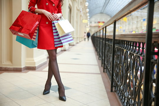 elegant woman is enjoying shopping close up in a luxury mall