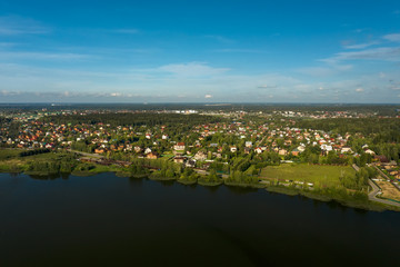 Aerial view of the lake and village houses located on its shore