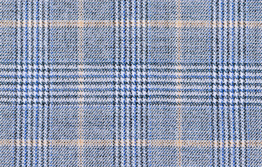 Beige Glenurquhart check is made of blue woolen fabric. Classic  Wool Background Texture. Coat close-up. Expensive men's suit
