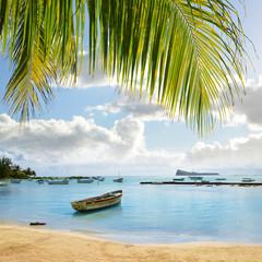 Boats on the sea in Cap Malheureux, Mauritius island, Indian Ocean.