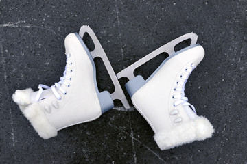 Pair of skates for figure skating on ice rink.