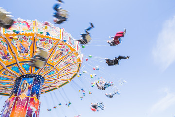 Chain carousel ride in an amusement parks carnivals or funfair, Munich, German Fototapete
