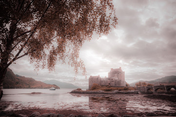 Fantasy colors panorama of Eilean Donan castle, Dornie, Scotland. Concept: fantastic and mythological places, travel to famous places in Scotland