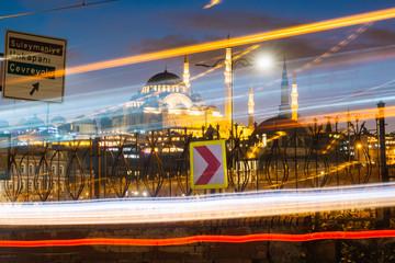 Istanbul, Turkey - Jan 15, 2020: Suleymaniye Mosque with Galata Bridge at night, Istanbul, Turkey.