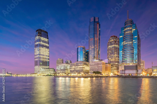 Fotomurales Skyline of Jersey City, New Jersey from New York Harbor