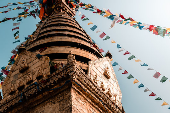 Buddhist building, the Swayambhunath Stupa or monkey temple during the day and its prayer flags fluttering in the wind, Nepal, Kathmandu