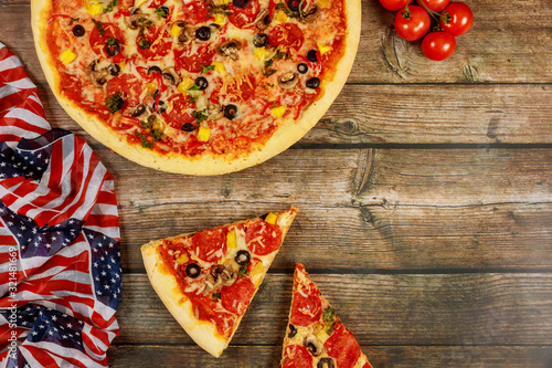 Pizza party for american holiday on wooden table.