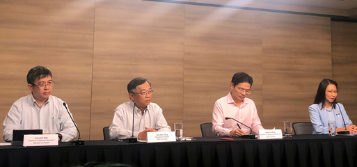 Members of multi-ministry taskforce handling the coronavirus outbreak give a news conference in Singapore