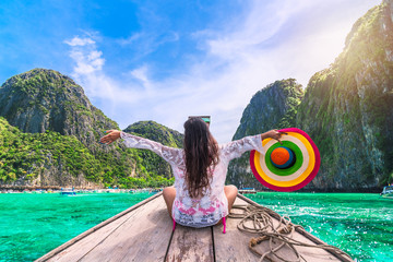 Happy traveler woman in beach wear joy fun on boat, Maya bay Phi Phi island Krabi, Attraction place tourist travel Phuket Thailand summer holiday vacation trips, Tourism beautiful destinations Asia
