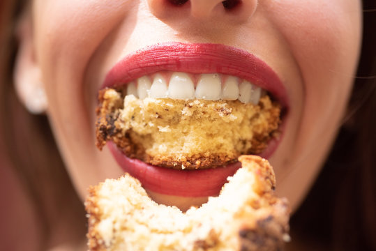 Hunger. Closeup of woman eating. Meal. Female lips. Closeup woman face. Mouth wide open.
