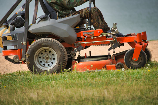 mowing grass on a lawn mower of large areas