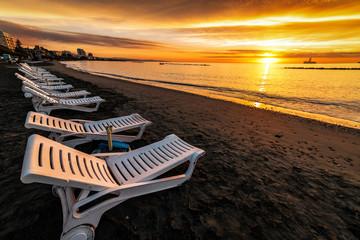 sun beds on beautiful sunrise