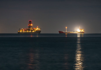 Two industrial ships are at anchor