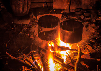 two tourist bowls over fire