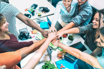 Young employee startup workers stacking hands at urban studio workspace on entrepreneurship brainstorming project - Business motivation concept with human resources on working time - Azure filter