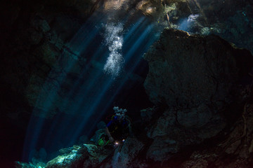 Cave diving in mexico cenote