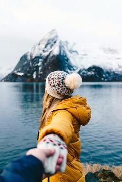 Tourist couple at Hamnoy, Lofoten, Norway