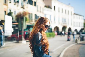 Italy, Padua, woman crossing the road