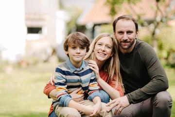 Happy family in garden, portrait