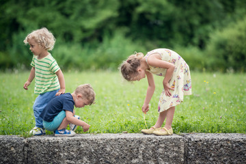 Three little children playing together
